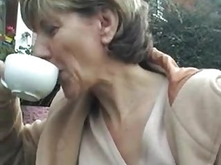 British sex mommy is sitting at the table and demonstrating her hollow under skirt