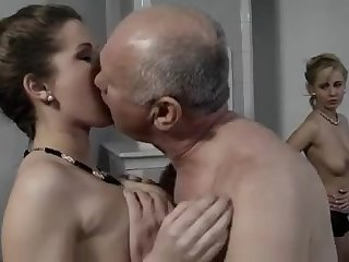 An old sex dodderer is pleasing two slender sluts at the same time