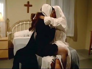 Красивые сисястые монашки страстно занялись лесбийским сексом в спальне